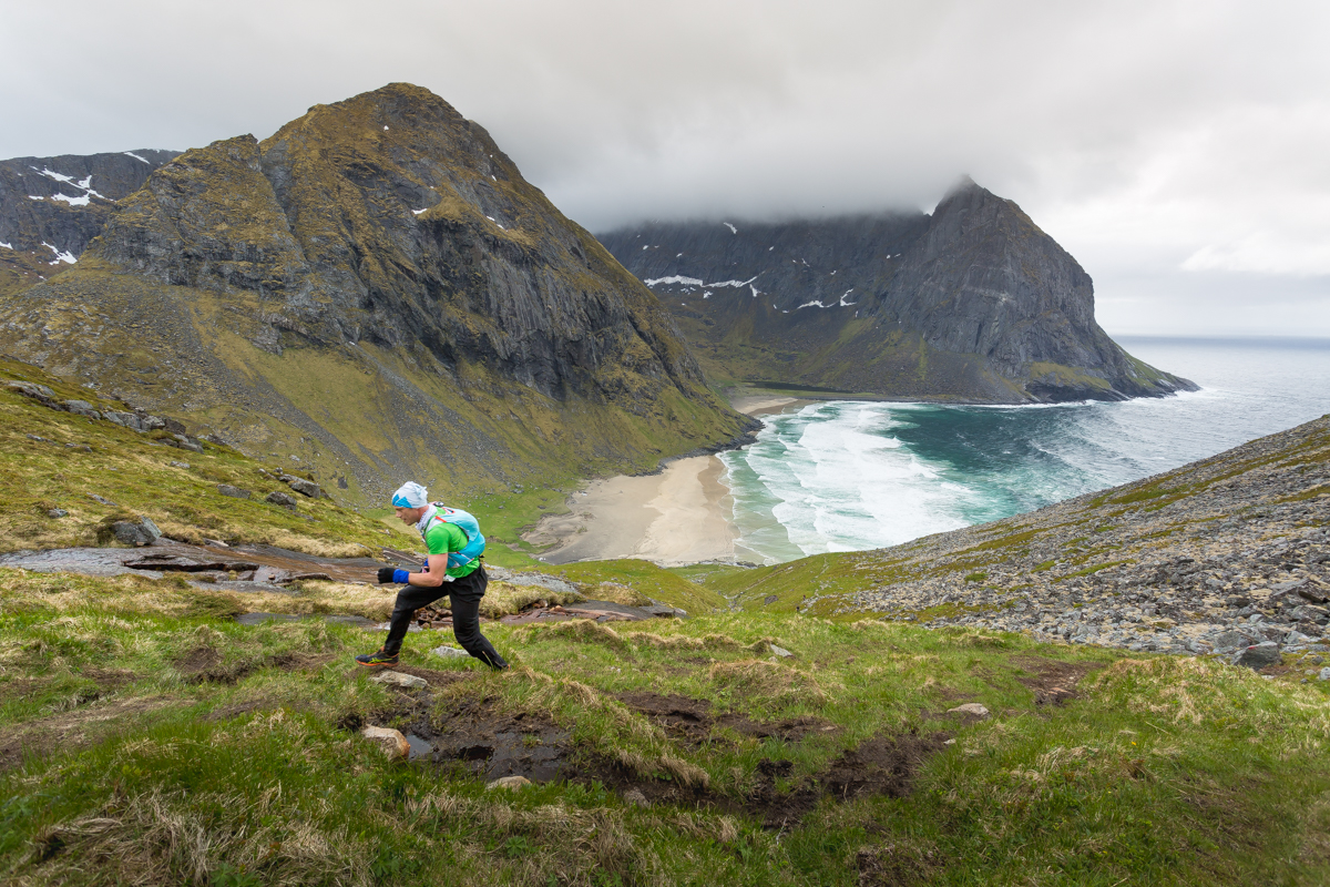 The amazing vista of the beach at Kvalvika is totally ignored by the runners of the 100 mile race, during the Lofoten Ultra Trail 2016.
