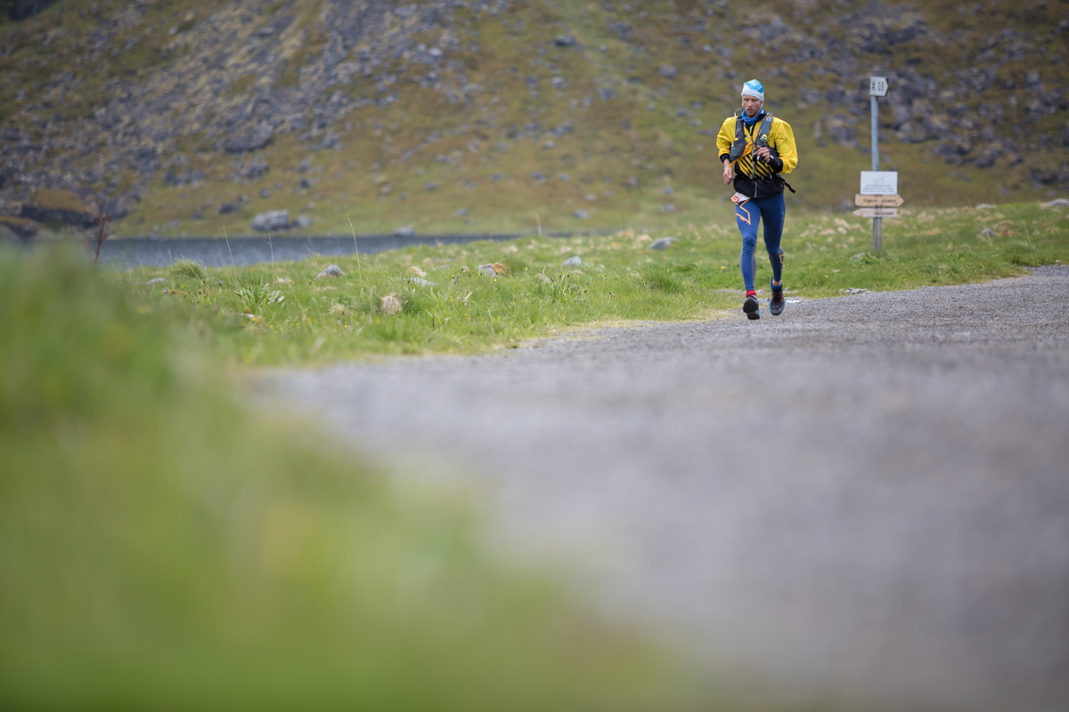 A runner on the trail between Unstad and Eggum during the 50 miles race of the Lofoten Ultra Trail 2016.