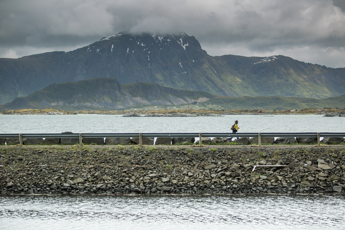 A runner on the road between Eggum and Bøstad during the 2016 Lofoten Ultra Trail.