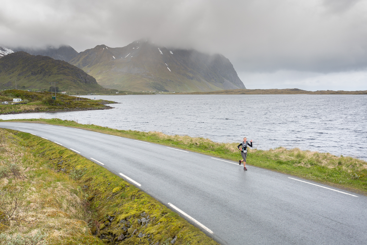 Joanna Zakrzewski runs a stretch of road between two trail sections of the 50 miles race of the Lofoten Ultra Trail 2016.