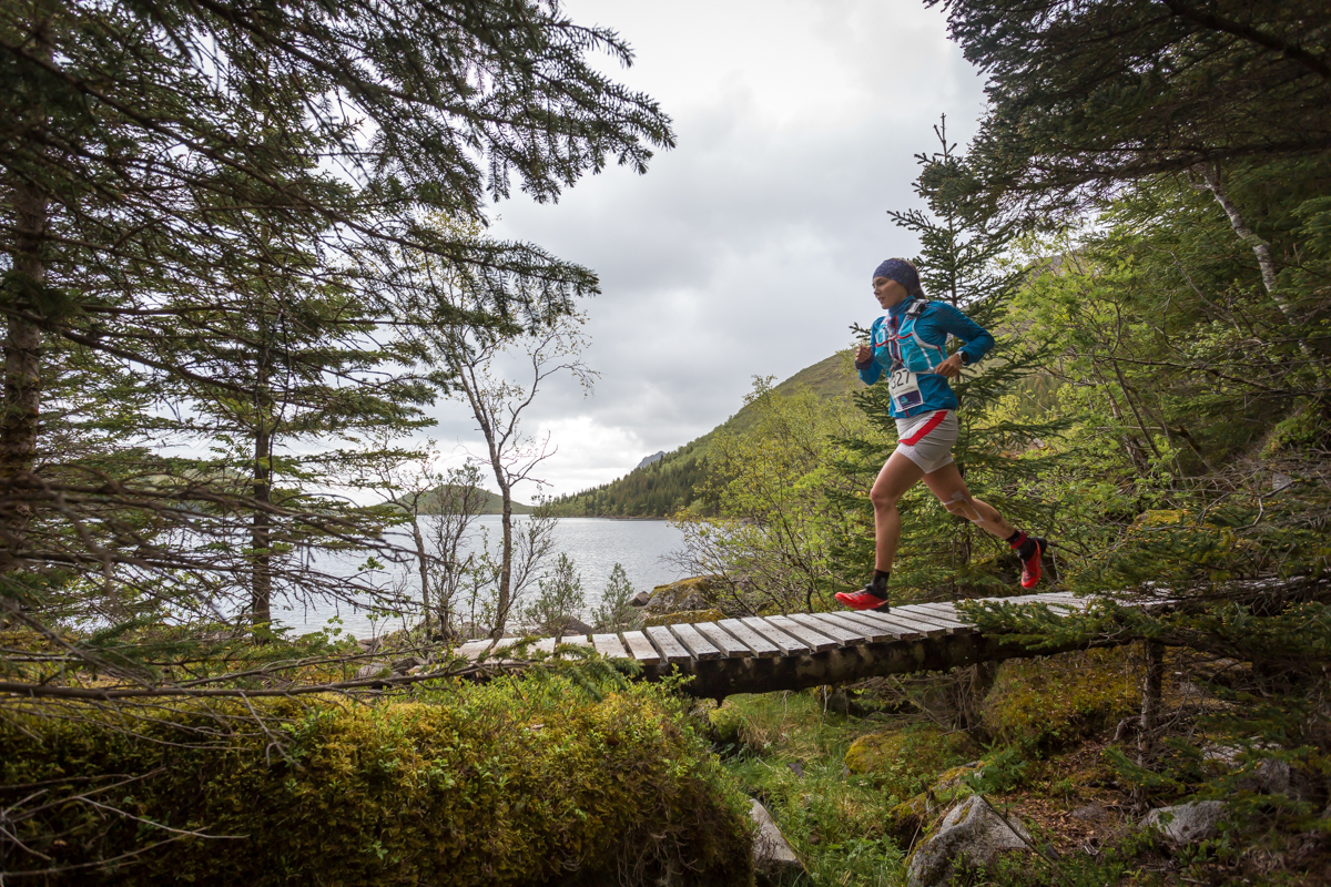 Yngvild Kaspersen, winner of the 24 km race of the Lofoten Ultra Trail 2014, crosses a bridge in the woods next to Stor Kongsvatnet lake, close to Svolvær.